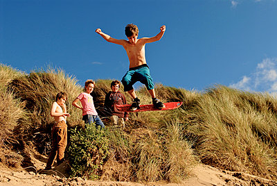 Young Boys, Sand Dunes, Jump - p1304m1136838 by MY MY