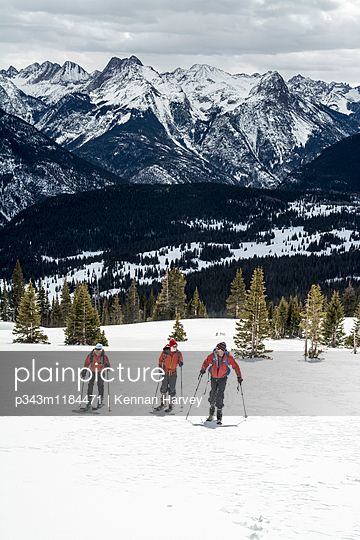 A group of backcountry skiers in the San Juan National Forest, Silverton, Colorado.