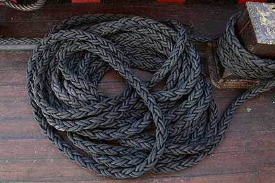 Coiled rope on a tall ship. - p1072m1056292f by KuS