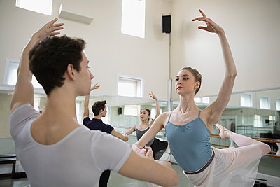 Male and female ballet dancers practicing in dance studio - p1192m1403473 by Hero Images