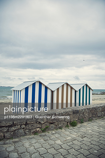 Three beach huts - p1198m2291803 by Guenther Schwering