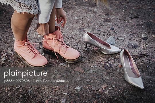Changing shoes and style - p858m2272628 by Lucja Romanowska