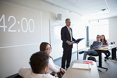 Teacher leading debate club lesson in classroom - p1192m1473289 by Hero Images