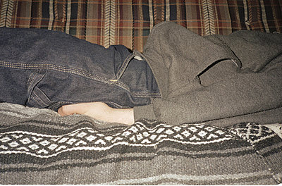 Sleeping on a couch - p5670520 by Jesse Untracht-Oakner