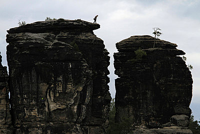 A person preparing to rappel down a rock formation, Saxon Switzerland, Saxony, Germany - p30120338f by Gerhard Fitzthum