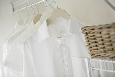 Close-up of clean, white shirts in closet. - p328m784034f by Hero Images