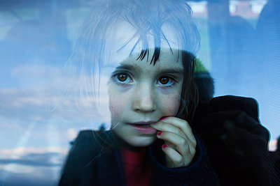 Portrait Of A Girl Seen Through The Car Window  - p847m1529355 by Mikael Andersson