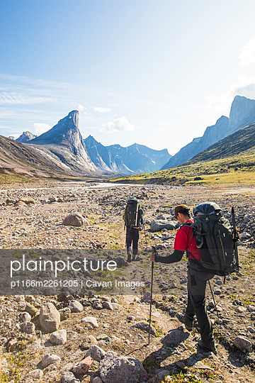 Backpacker hiking on trail towards Mt. Thor, Baffin Island. - p1166m2261205 by Cavan Images