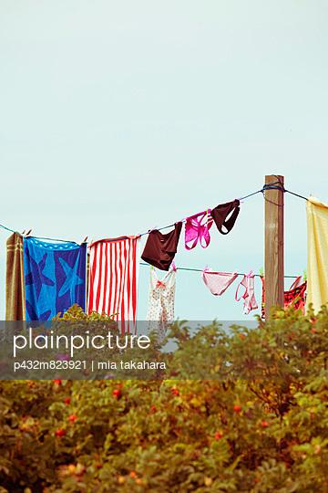 Drying laundry - p432m823921 by mia takahara