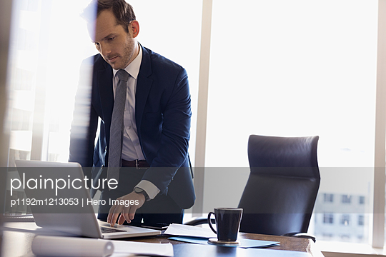 Male lawyer working at laptop in conference room