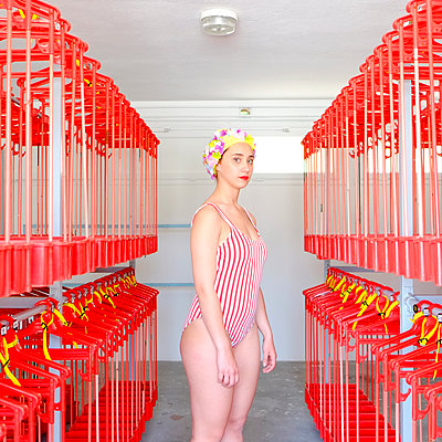 Young woman with bathing cap in swimming baths - p1521m2081639 by Charlotte Zobel