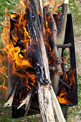 Wood burning in a barbeque - p301m714206f by Halfdark