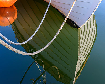 Boat reflecting in water - p312m956860f by Mikael Svensson