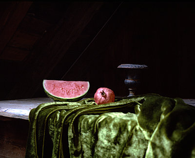 Melon and pomegranate placed on velvet - p945m1480848 by aurelia frey