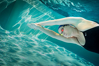 Young female swimmer during training - p1554m2272608 by Tina Gutierrez