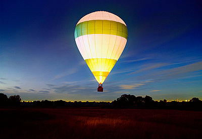 Hot air balloon at night - p4298276 by Simon McComb