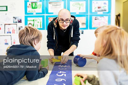 Teacher with students in art class at kindergarten