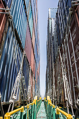 Piled up containers - p1157m1041452 by Klaus Nather