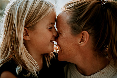 Happy mother and daughter together - p312m2237148 by Anna Johnsson