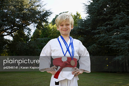 Boy in Karate Kit, with medals