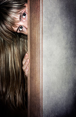 Woman behind a door - p1390m1440740 by Svetlana Sewell