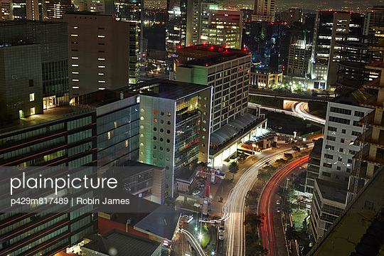 City center lit up at night - p429m817489 by Robin James