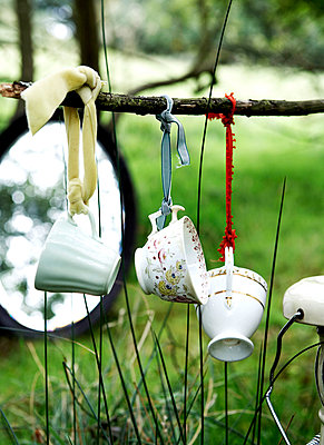 China cups tied with ribbon in woodland with mirror;  Isle of Wight;  UK - p349m920045 by Rachel Whiting