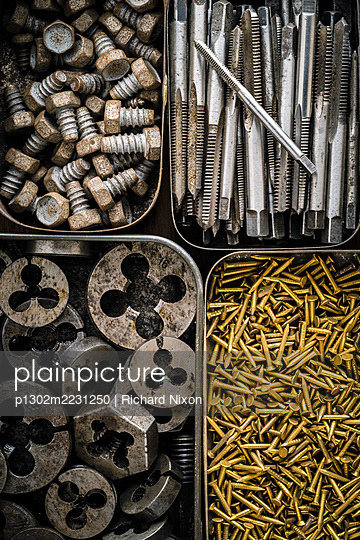 Metal tins containing old tools and fasteners - p1302m2231250 by Richard Nixon