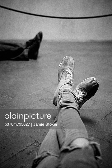 Dirty shoes and jeans - p378m795827 by Jamie Stoker