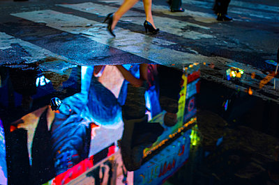 Reflection of a neon sign in a puddle, Times Square, Midtown, Manhattan, New York, USA - p1316m1422445 by Daniel Schoenen