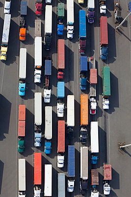 Aerial View of Semi Trucks at a Port - p555m1453757 by Spaces Images
