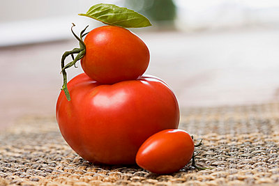 Stack of tomatoes - p9248366f by Image Source