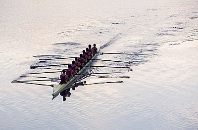 Rowing team rowing scull on lake - p1023m923616f by Chris Ryan