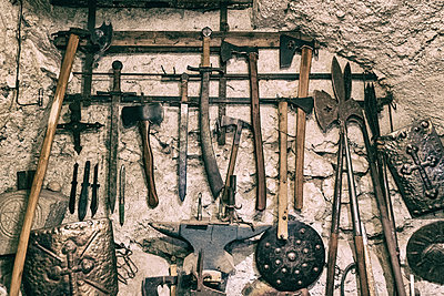 Close-up of various ancient tools hanged on old wall - p1166m2011567 by Cavan Social