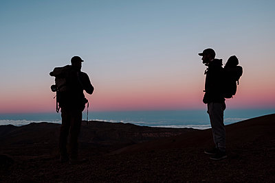 Photographers at sunset in the volcano Teide, Tenerife - p1166m2131168 by Cavan Images