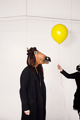 Person With A Mask Of A Horse's Head And A Person With A Yellow Balloon    - p847m1102800 by Johan Strindberg