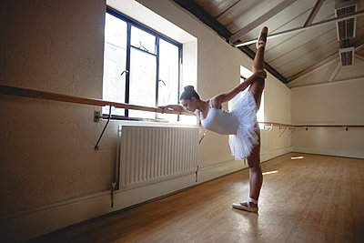 Ballerina practising ballet dance at barre - p1315m1198763 by Wavebreak