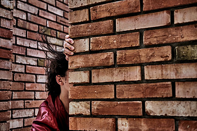Man on brick wall - p491m2253574 by Ernesto Timor