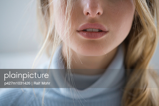 Woman in serious mood - p427m1031426 by Ralf Mohr