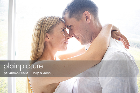 Couple in love embracing lovingly - p1640m2259561 by Holly & John