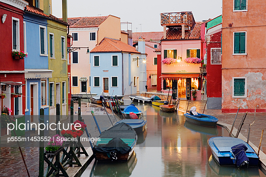 Boats in Burano Canal During a Rain Shower - p555m1453552 by Spaces Images