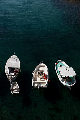 Three boats and a barge - p445m1020487 by Marie Docher