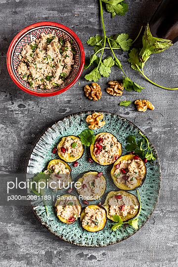 Baked aubergine slices spread with walnut creme garnished with pomegranate seeds - p300m2081189 by Sandra Roesch