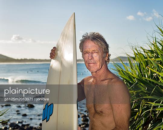 Surfer portrait at surfbreak - p1125m2013971 by jonlove