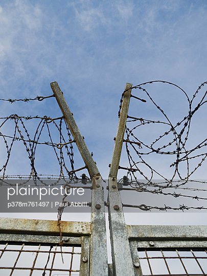 Barbed wire metal gate - p378m761497 by Paul Abbitt