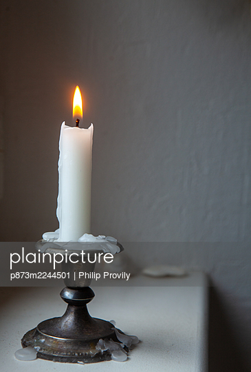 Single candle - p873m2244501 by Philip Provily