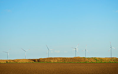 Brown coal and wind turbine - p1132m1039973 by Mischa Keijser