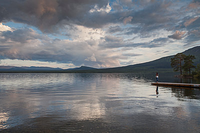 Pier on lake in Jatmland, Sweden - p352m1536566 by Calle Artmark