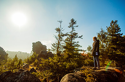 Caucasian hiker admiring view from remote hilltop - p555m1412090 by Aleksander Rubtsov