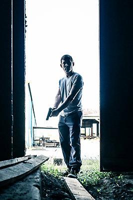 Armed man - p1019m2122105 by Stephen Carroll